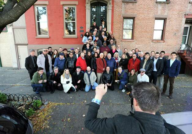 """Photographer Douglas C. Liebig takes a group photo inspired by the historic Art Kane picture """"Harlem 1958,"""" which was the subject of the documentary """"A Great Day in Harlem,"""" Saturday Nov. 8, 2014, on Madison Avenue in Albany, N.Y.(Michael P. Farrell/Times Union) Photo: Michael P. Farrell / 00029343A"""