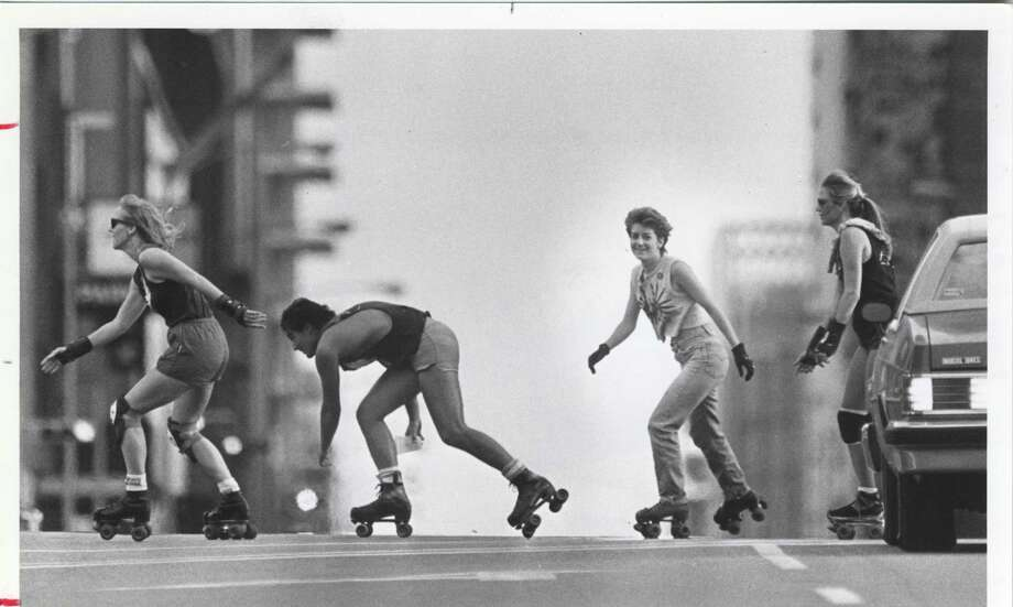 This June 6, 1984 photo show the Urban Animals in typical form, skating on city streets, celebrating the fifth anniversary of the founding of their organization by skating at Milam and Preston in downtown Houston. The group also held a barbecue in Old Market Square. Photo: Ben Desoto, Houston Chronicle / Houston Chronicle