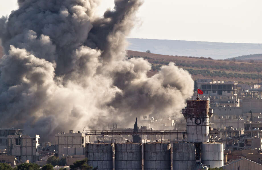 A Turkish flag flies on a grain silo in the town of Kobani, after an air strike by the U.S. led coalition. Photo: Vadim Ghirda / Associated Press / AP