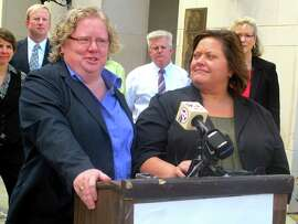 Colleen Condon (left) and her partner, Nichols Bleckley, appear at a news conference in Charleston, S.C., shortly after filing a federal lawsuit in October seeking the right to marry in South Carolina. U.S. District Judge Richard Gergel ruled in their favor in the case, striking down the state's same-sex marriage ban as unconstitutional on Wednesday. He gave the state a week to appeal his ruling before marriage licenses will be issued.