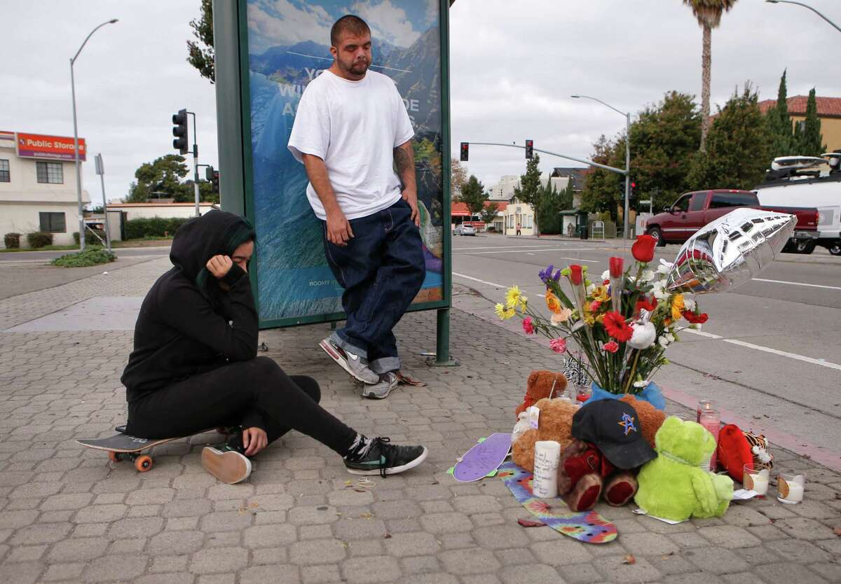 Viviana Alarcon (left) and Sky Zaste mourn the loss of their friend Ivan Cruz at a memorial on the corner of Ashland Avenue and East 14th Street near San Leandro, where the boy was killed ny a hit-and-run driver Tuesday.