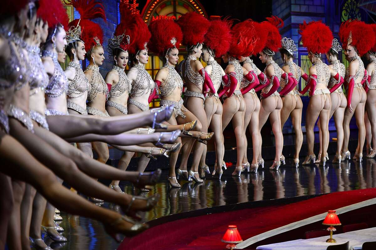 Kicking for a record: Moulin Rouge dancers bid to break the Guinness book record for the most consecutive high kicks by a single chorus line in 30 seconds. The ones on the right display considerably more realistic figures than Kim Kardashian.