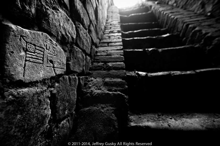 These carvings were done by American soldiers living in underground cities during WW1. Many left messages for loved ones, carved faces and even naked women. French, German and other nationalities also used the converted quarries to survive in, under the treches of France's western front line. Photo: Jeffrey Gusky
