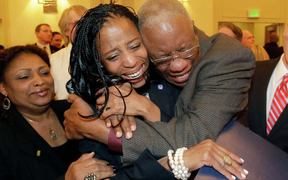 Republican Mia Love (center) celebrates with her father, Jean Maxime Bourdeau, after winning the race in Utah.'s 4th Congressional District during a GOP election night watch party, Tuesday, Nov. 4, 2014, in Salt Lake City. (AP Photo/Rick Bowmer) Photo: Rick Bowmer / Associated Press / AP