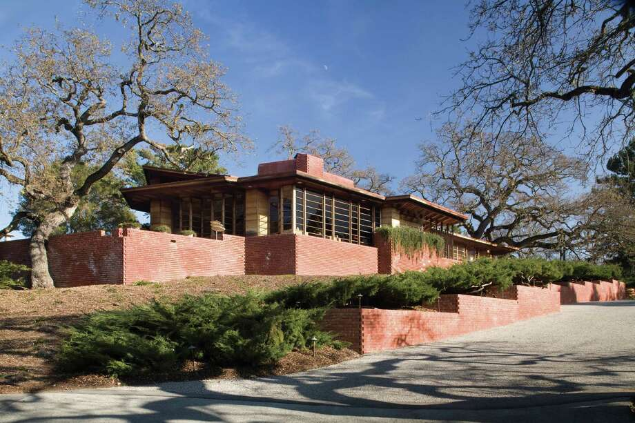 "Hanna House, Stanford: This reddish-colored ranch home designed by Frank Lloyd Wright in 1936 is also known as the ""Honeycomb House"" because it's design is based on the hexagonal-shaped honeycomb produced by bees. Guided tours available: find details at hannahousetours.stanford.edu. Photo: Joel Puliatti / ONLINE_YES"