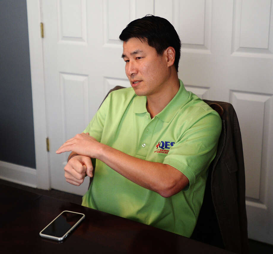 Dr. Victor Ho describes the sound of a man working the slide on a pistol as he recounts walking in on his home being robbed. Ho is offering to pay for the education of the young men who robbed his Houston home if they turn themselves in and do their time. Photo taken Wednesday 11/12/14 Jake Daniels/The Enterprise Photo: Jake Daniels / ©2014 The Beaumont Enterprise/Jake Daniels