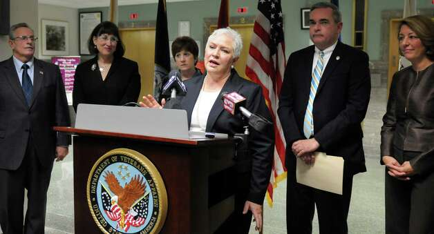 VA Medical Center director Linda Weiss, center, speaks during an announcement of a joint initiative to end veteran homelessness on Wednesday, Nov. 12, 2014, at the VA Medical Center in Albany, N.Y. Joining her, from left, are Troy Mayor Lou Rosamilia, Amsterdam Mayor Ann Thane, Albany Mayor Kathy Sheehan, Schenectady Mayor Gary McCarthy and Saratoga Springs Mayor Joanne Yepsen. Five Capital Region cities are uniting to find innovative housing solutions for homeless veterans. (Cindy Schultz / Times Union) Photo: Cindy Schultz / 00029443A