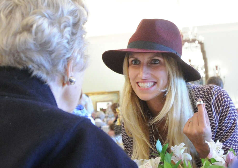 Jeweler, Haverhill Leach of Providence, Rhode Island, right, displays a Sterling silver and blue Topaz ring that she was selling during the Greenwich Exchange for Women's Work annual Gift Fair at the Round Hill Club, Greenwich, Conn., Wednesday, Nov. 12, 2014. The fair continues at the Round Hill Club on Thursday, Nov. 13, from 10 a.m. to 4 p.m., with a luncheon available from noon-2 p.m. The Greenwich Exchange for Women's Work is a non-profit organization whose mission is to support the art of handcrafted items by providing a marketplace for talented artisans-consignors. Photo: Bob Luckey / Greenwich Time