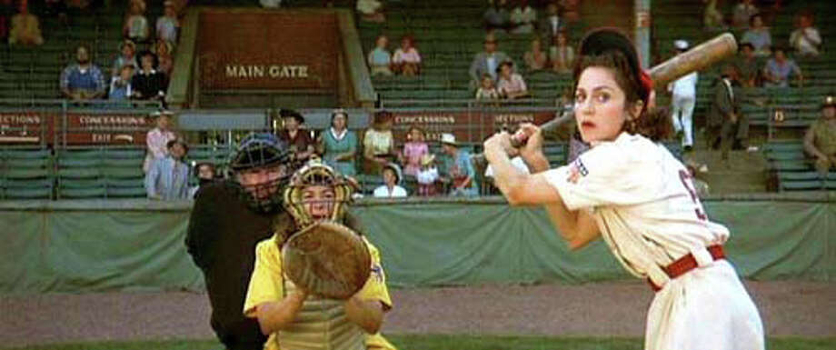 "Madonna steps up to the plate in her role as Mae Mordabito in a scene from the 1992 comedy-drama ""A League of Their Own."" A screening of the movie on Sunday, Nov. 16. benefits a pair of local nonprofits, Project Return and the Westport Cinema Initiative. Photo: Westport News/Contributed Photo / Westport News"