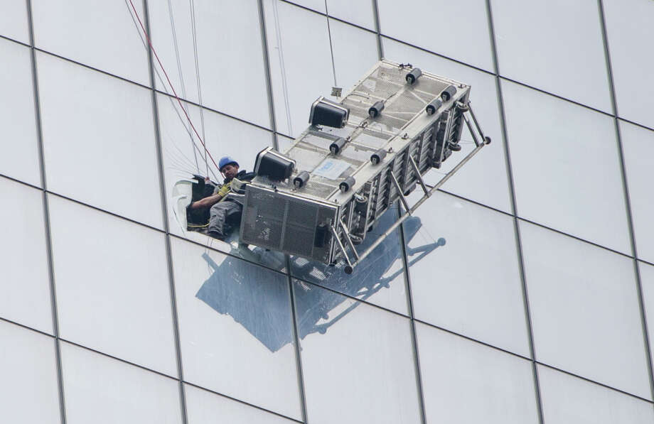 One of two window washers who were on a scaffold that malfunctioned is pulled to safety 69 stories up on the new World Trade Center building. Photo: FRED R. CONRAD / New York Times / NYTNS