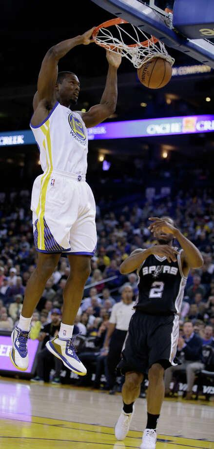 Harrison Barnes scores on the Spurs' Kawhi Leonard; coach Steve Kerr says Barnes can be every bit as good as Leonard. Photo: Ezra Shaw / Getty Images / 2014 Getty Images
