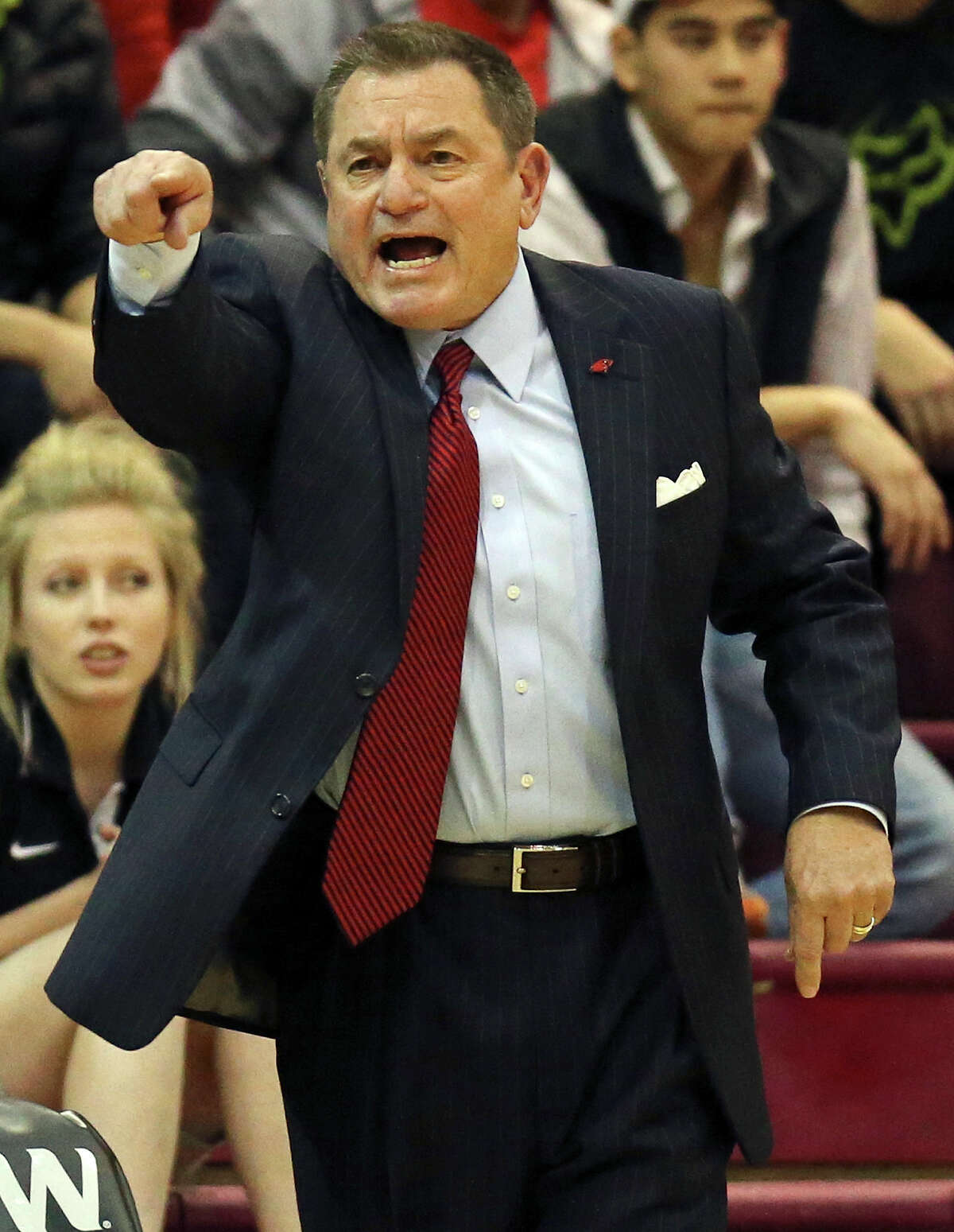 University of the Incarnate Word head coach Ken Burmeister yells instructions to the team during second half action against Abilene Christian University Thursday Feb. 13, 2014 at the Alice P. McDermott Convocation Center on the UIW campus. UIW won 80-68.