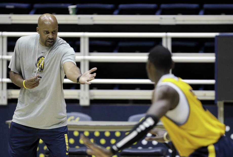Stanford coach Johnny Dawkins (left) has newfound job security thanks to the Cardinal's NCAA run; new coach Cuonzo Martin brings high energy to Cal. Photo: Carlos Avila Gonzalez / The Chronicle / ONLINE_YES