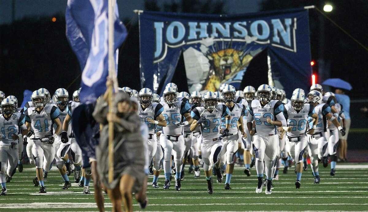 Johnson Jaguars take the field against Lee at Comalander Stadium on Sept. 26, 2014.