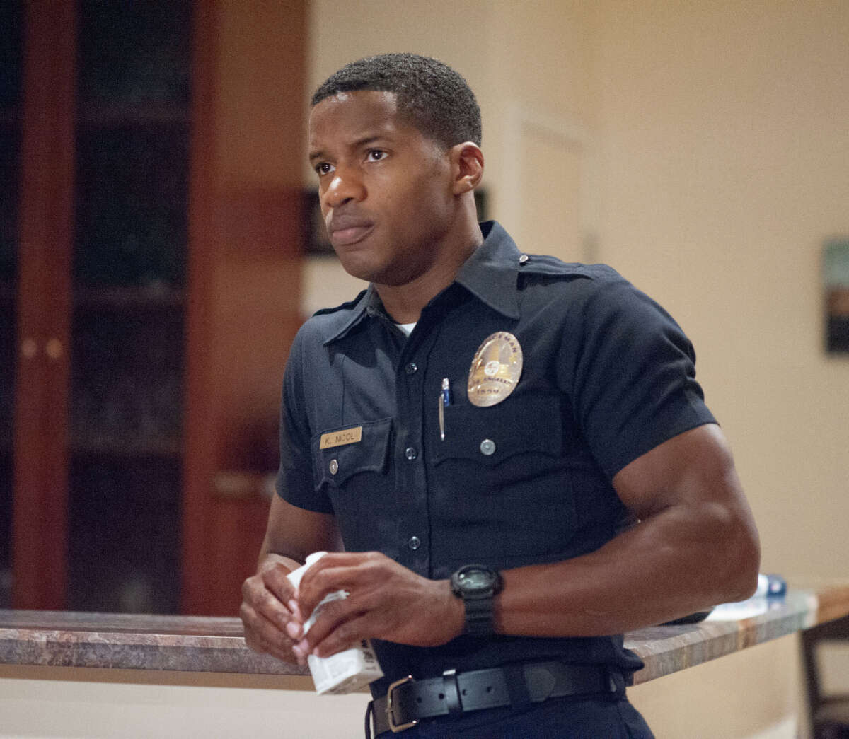 """A fierce stage mom (Minnie Driver, top left) sees her British pop star daughter (Gugu Mbatha-Raw) on the verge of U.S. fame when the singer meets a handsome young cop (Nate Parker, below) in """"Beyond the Lights."""" Nate Parker plays a young police officer who meets a British pop star (Gugu Mbatha-Raw) reaching for U.S. stardom in Relativity Media's """"Beyond the Lights."""""""
