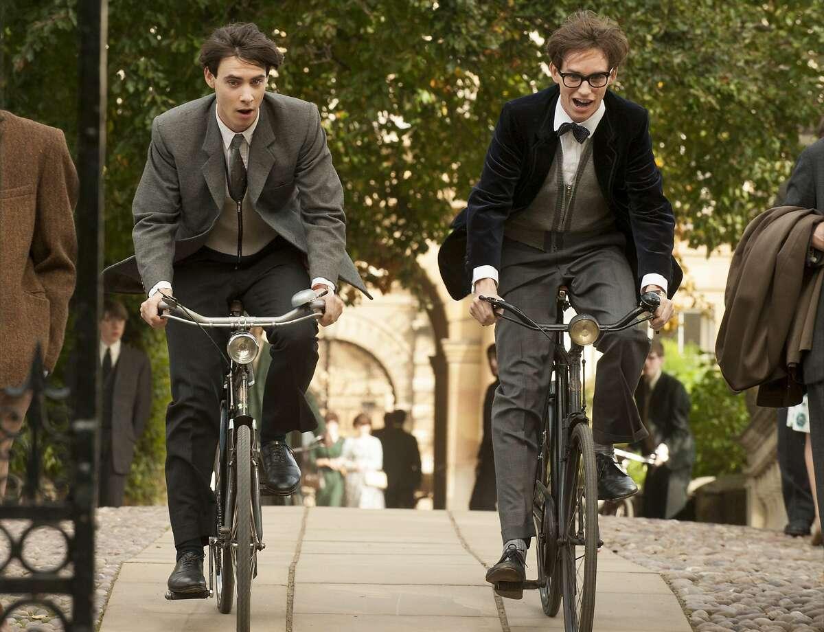 Harry Lloyd, left, stars as Brian and Eddie Redmayne stars as Stephen Hawking in Academy Award winner James Marsh's