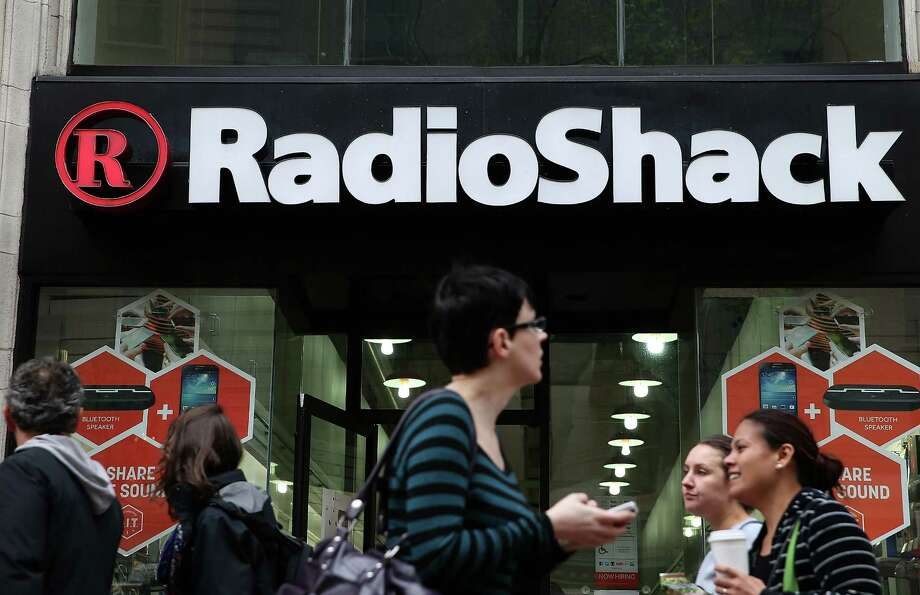 Discussions reported between RadioShack Corp. and Sprint Corp. could bring an end to RadioShack's nine-decade existence. FILE - SEPTEMBER 11: According to September 11, 2014, electronics retailer RadioShack said it may have to file for Chapter 11 bankruptcy. SAN FRANCISCO, CA - MARCH 04: People walk by a Radio Shack store on March 4, 2014 in San Francisco, California. RadioShack announced plans to close over 1,000 of its underperforming stores, approximately 20 percent of its retail locations, as part of a restructuring to be more competitive in retail electronics. (Photo by Justin Sullivan/Getty Images) Photo: Justin Sullivan /Getty Images / 2014 Getty Images