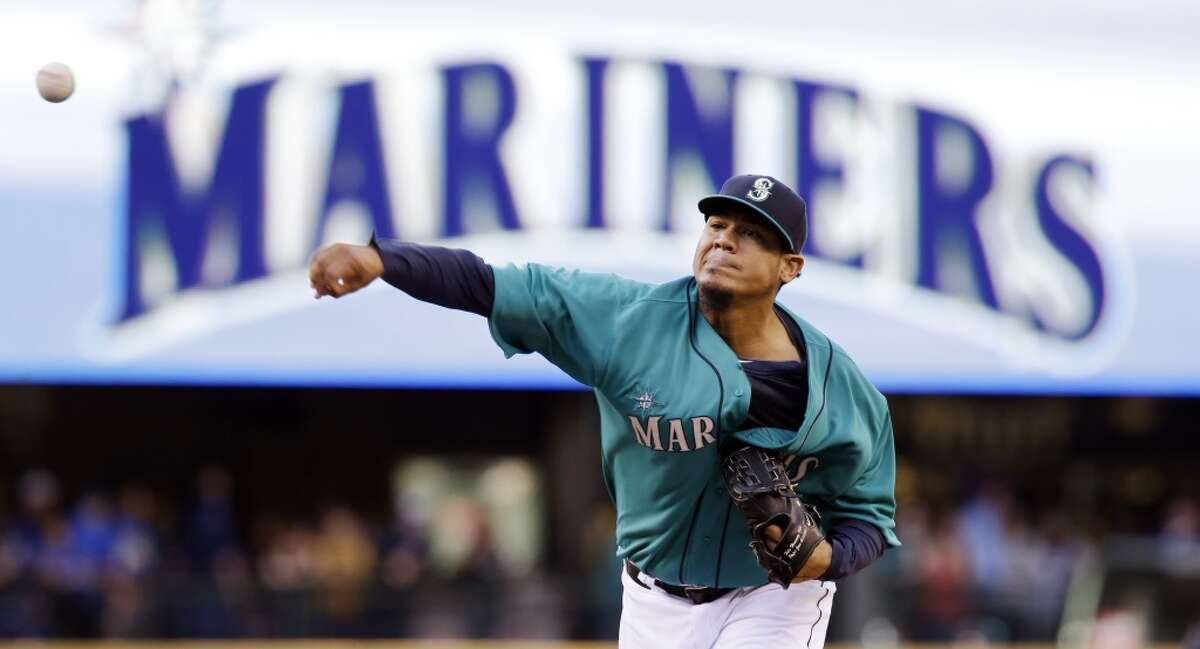 Seattle Mariners staring pitcher Felix Hernandez throws warm-ups before a baseball game against the Houston Astros Friday, May 23, 2014, in Seattle. (AP Photo/Elaine Thompson)