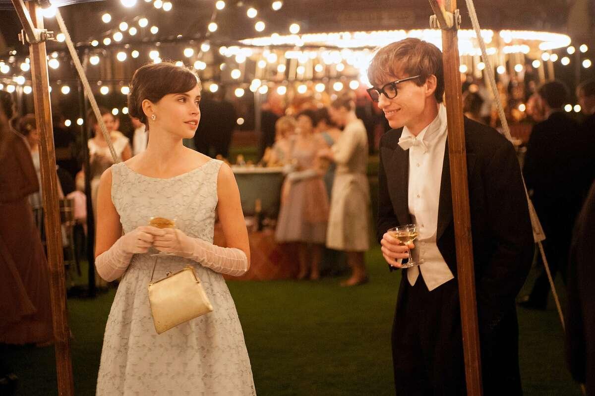 Felicity Jones, left, stars as Jane Wilde and Eddie Redmayne stars as Stephen Hawking in Academy Award winner James Marsh's