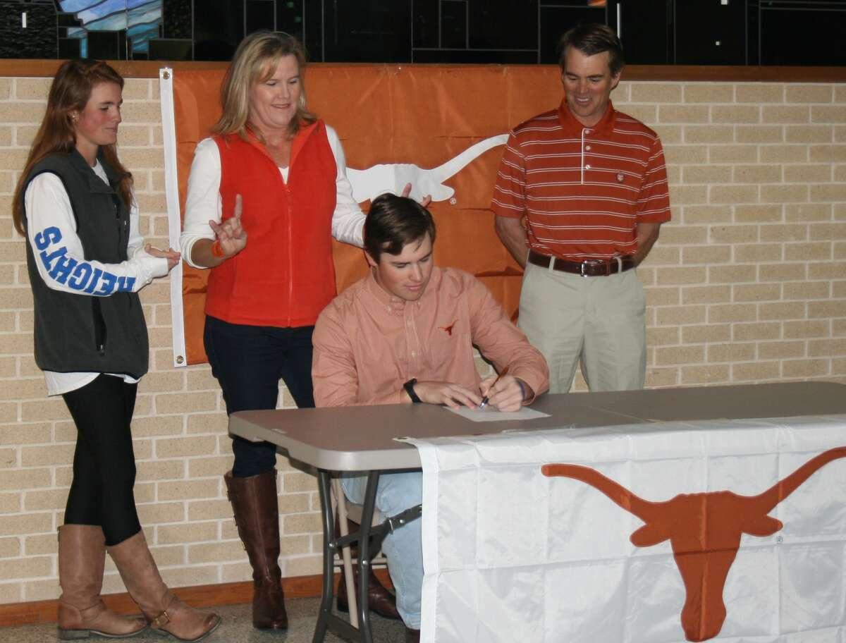 Alamo Heights' James Nittoli signs a baseball letter of intent with the University of Texas on Wednesday.