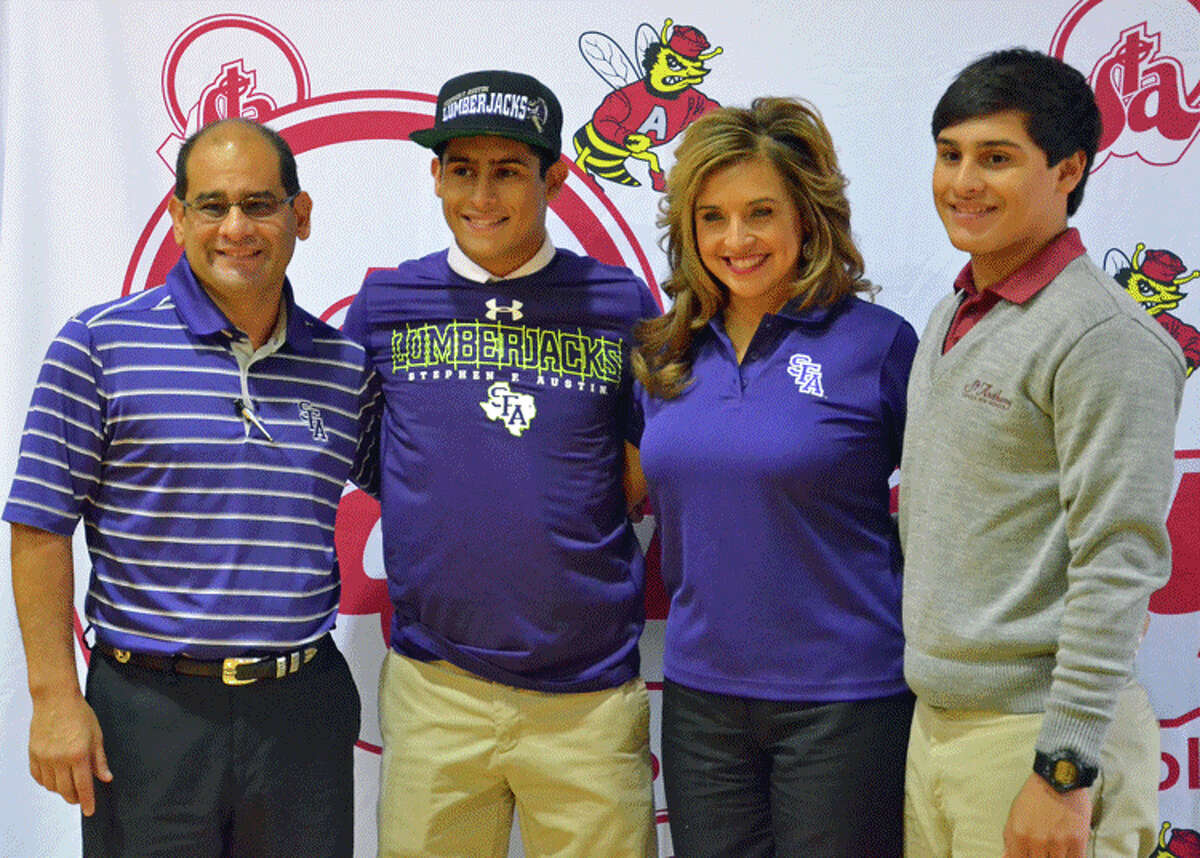 St. Anthony senior baseball player Henry Sanchez sports the gear for Stephen F. Austin during his signing ceremony with the Texas college.