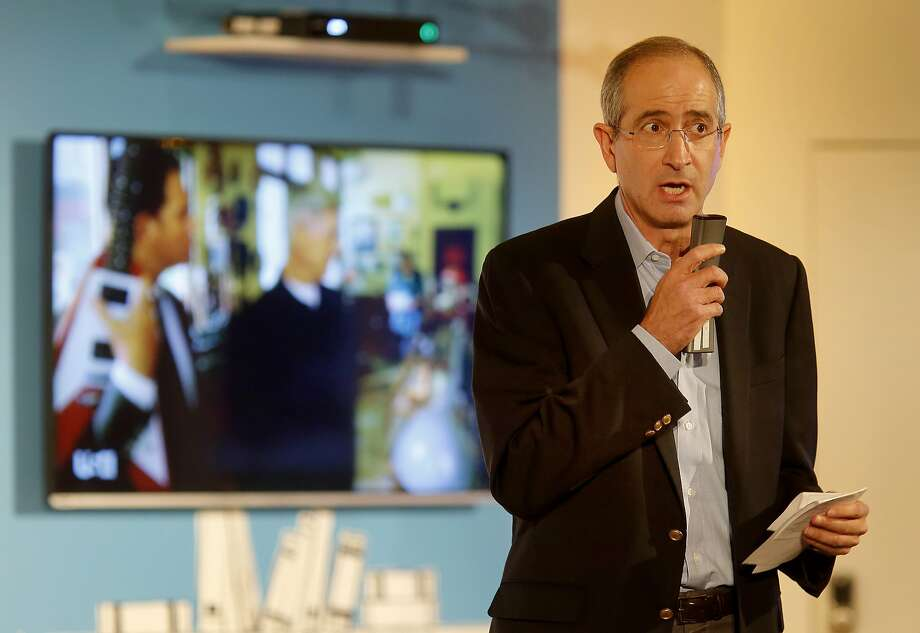 Brian Roberts demonstrated the new talking function for the remote control Wednesday November 12, 2014. Comcast CEO Brian Roberts made an appearance with other company officials to reveal their X1 cable products in San Francisco, Calif. and talk about the internet debate. Photo: Brant Ward, The Chronicle