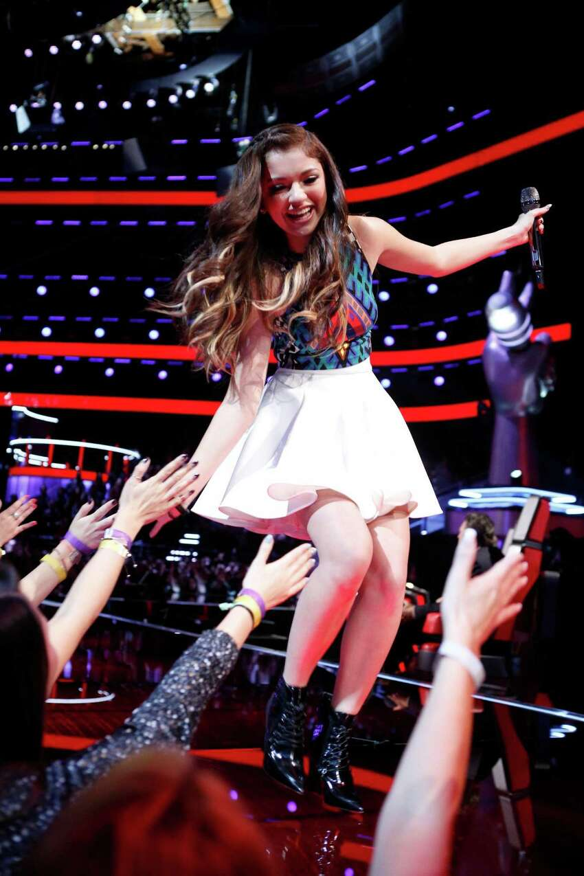 Cole High School alum Bryana Salaz, 17, connects with the audience during her first live performance show of 'The Voice' on NBC. November, 2014 THE VOICE --