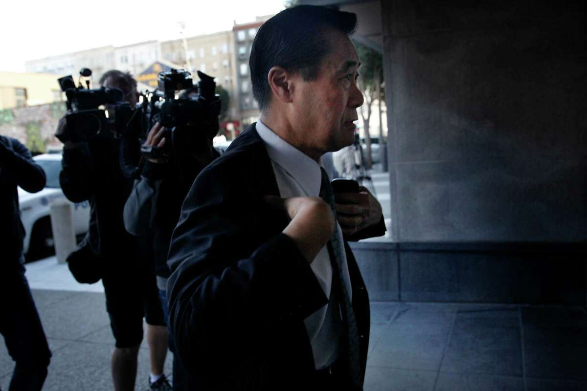 Suspended California state Sen. Leland Yee arrives at the Phillip Burton Federal Building and United States Courthouse for his arraignment on Tuesday, April 8, 2014, in San Francisco, Calif.