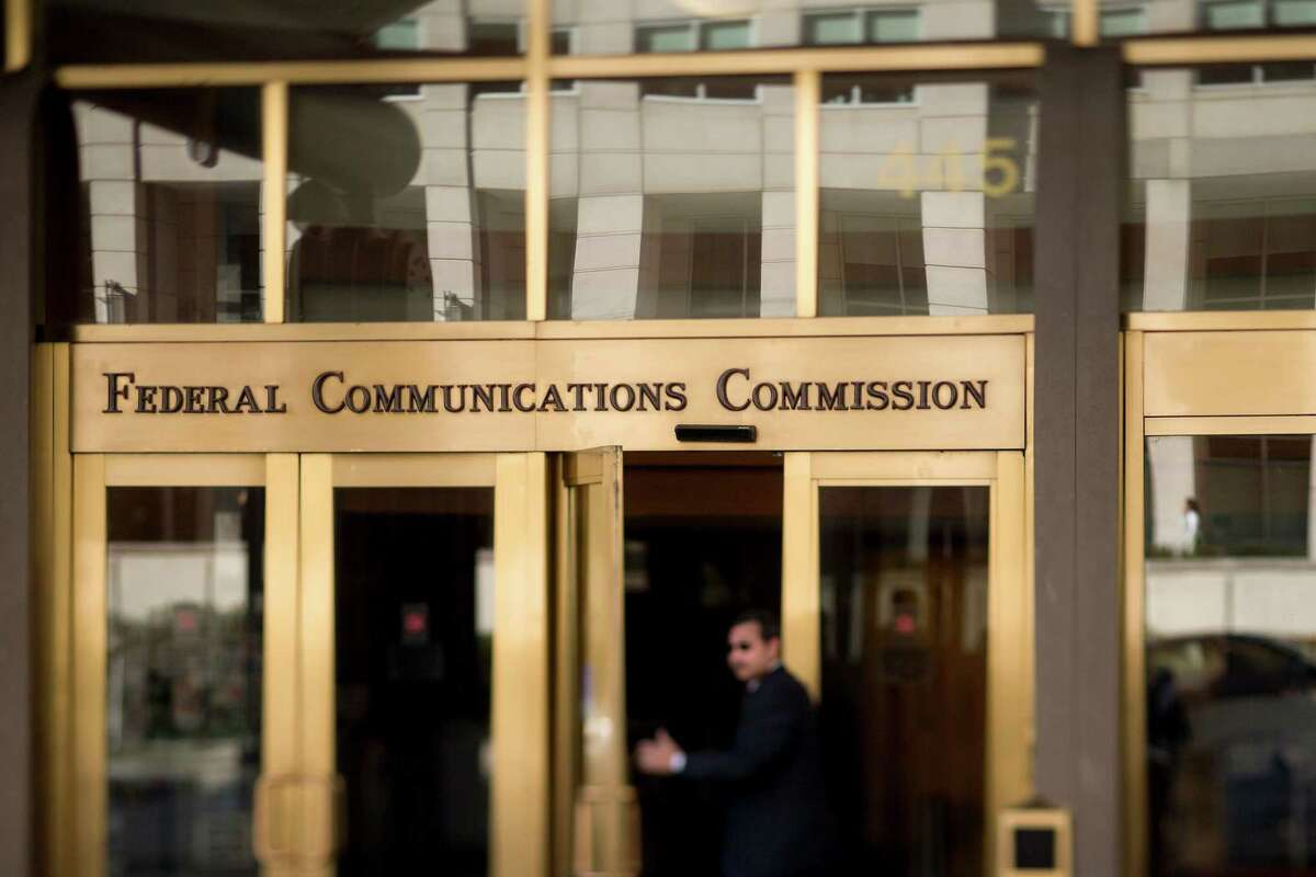 A man walks into the Federal Communications Commission (FCC) headquarters on Monday. President Barack Obama called for the