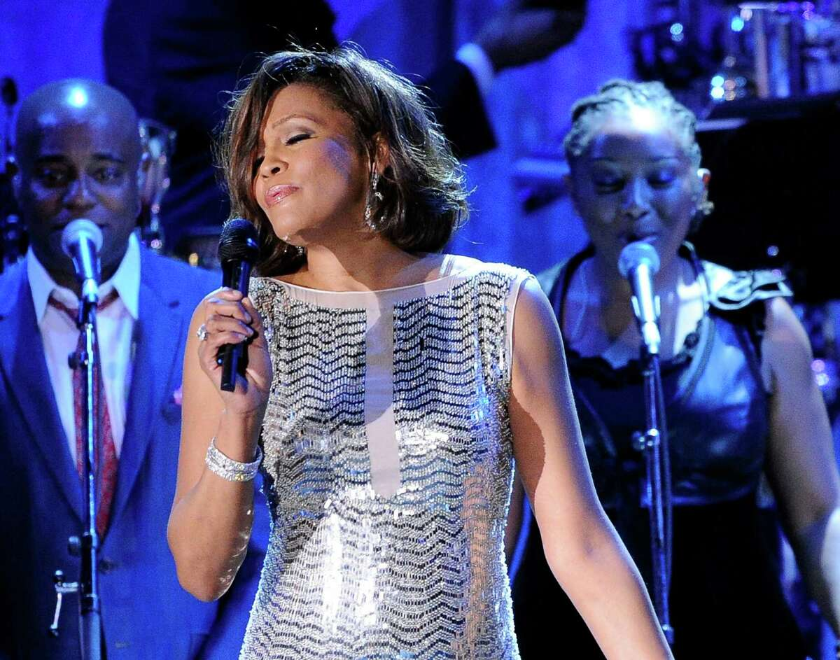 FILE - In this Feb. 13, 2011 file photo, singer Whitney Houston performs at the pre-Grammy gala & salute to industry icons with Clive Davis honoring David Geffen in Beverly Hills, Calif. Pat Houston, the late singer?'s sister-in-law and head of her estate, says she?'s had offers to debut a Whitney Houston hologram, but she won?'t sign on just yet. Whitney Houston died in 2012 at age 48. Acts from Michael Jackson to Tupac Shakur have been presented in hologram form. (AP Photo/Mark J. Terrill, File) ORG XMIT: NYET303
