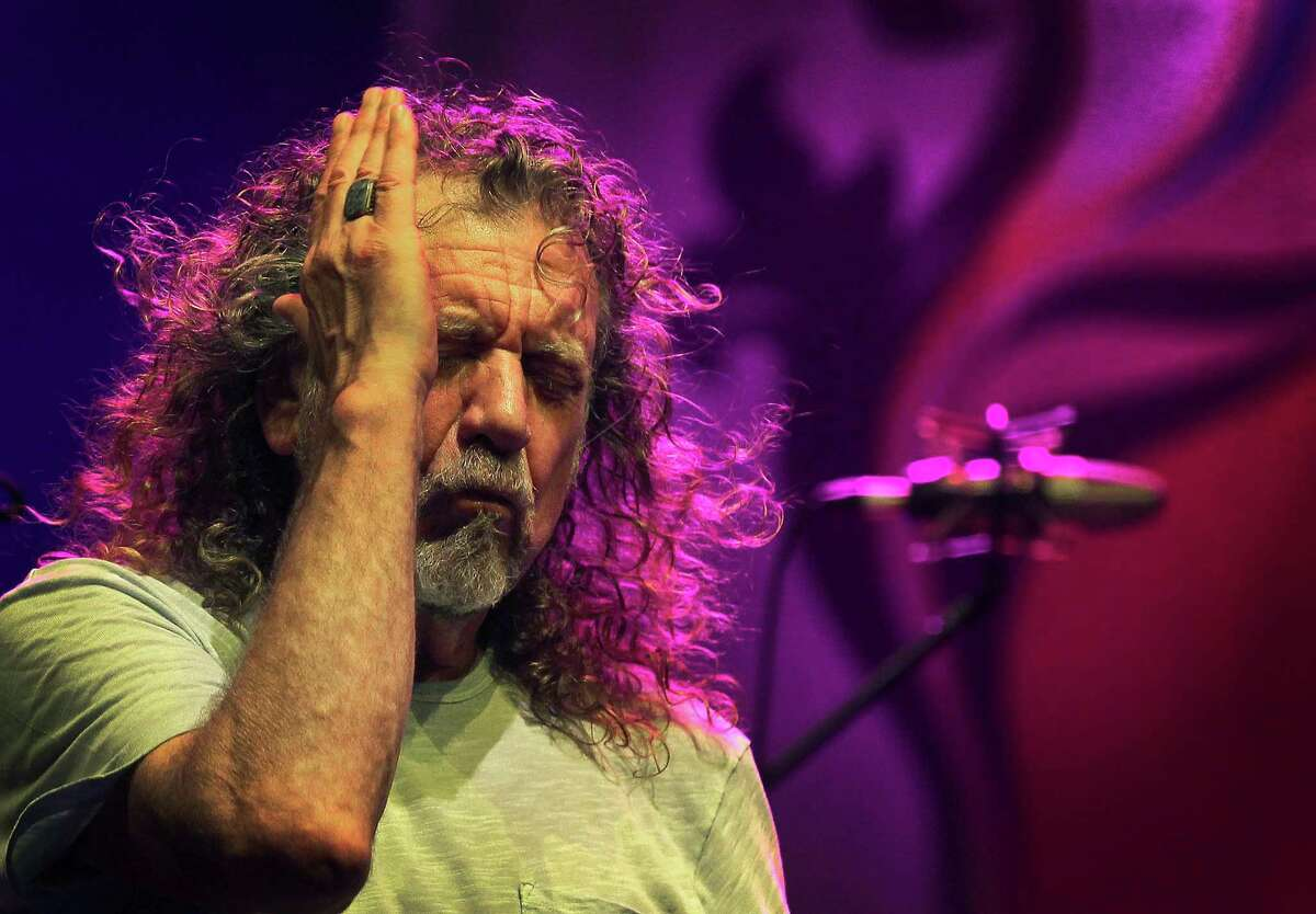 FILE - In this file photo dated Thursday March 21, 2013, Robert Plant, lead vocalist and lyricist of the rock band Led Zeppelin, performs during the Timbre Rock and Roots concert in Singapore. In a statement released from Plant spokesman Ken Weinstein, on Wednesday Nov. 12, 2014, Robert Plant says there is no truth to reports he turned down a lucrative offer from Virgin boss Richard Branson to play Led Zeppelin reunion shows. (AP Photo/Wong Maye-E, FILE) ORG XMIT: LON108