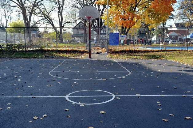 "A view of the newly resurfaced basketball court at Quackenbush Park on Wednesday, Nov. 12, 2014, in Schenectady, N.Y. TrustCo Bank officials held an unveiling at the park to show off the over $20,000 in improvements made and funded by the bank.  Rob McCormick, president and CEO of Trustco said that they wanted to help out in neighborhoods and they reached out to the mayor and then met with the neighborhood association. ""We see these neighborhoods as our neighborhoods,"" McCormick said. Along with resurfacing the basketball court, new picnic tables, benches and garbage cans were purchased for the park. McCormick said that the plan is to return to the park in the spring to repair any damage from winter and then decide on the next park to work on.  (Paul Buckowski / Times Union) Photo: Paul Buckowski / 00029457A"