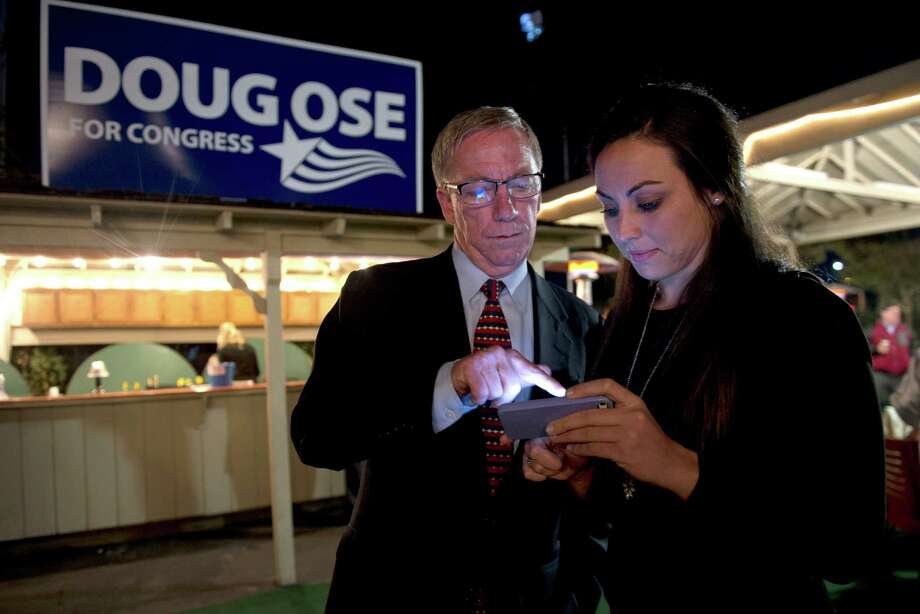 Former GOP Rep. Doug Ose, left, goes over results with Michawn Rich, right,  communications director, as he waits for results with supporters at Rudy's Hideaway on Tues., Nov. 4, 2014, in Rancho Cordova, Calif. He is challenging Democratic Rep. Ami Bera for his seat in Congress District 7. (AP Photo/The Sacramento Bee, Renee C. Byer) Photo: Renée C. Byer / Associated Press / The Sacramento Bee
