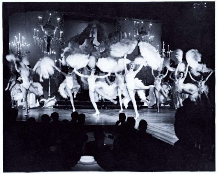 The Monorail and Space Needle were not the only big attractions during Seattle's 1962 World's Fair -- how about nudity and dancing women along Century 21's Show Street? The nightclub-style revues included Girls of the Galaxy, featuring models posing in revealing space-age costumes, and Gracie Hansen's Paradise International Club, which provided Las Vegas-style entertainment with showgirls. (MOHAI photo.)
