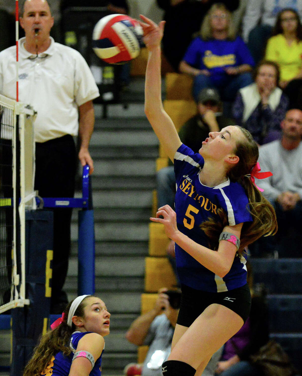 Seymour's Jillian Murphy spikes the ball, during Class S girls volleyball semifinal action against Morgan in East Haven, Conn. on Wednesday Nov. 12, 2014.