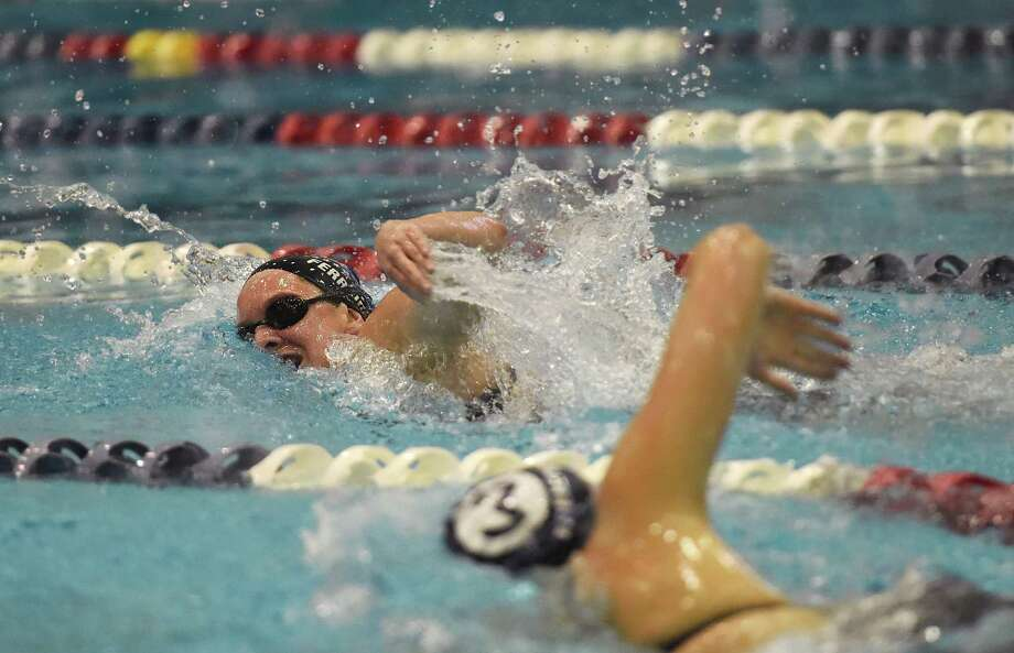 Darien's Courtney Ferreira, left, competes against Wilton's Katrina Trentos in the 500 yard freestyle at the CIAC Class L girls swimming championship at Southern Connecticut State University in New Haven, Conn. Wednesday, Nov. 12, 2014.  Ferreira won the event and Terntos placed fourth.  Darien won as a team, topping New Canaan. Photo: Tyler Sizemore / Greenwich Time