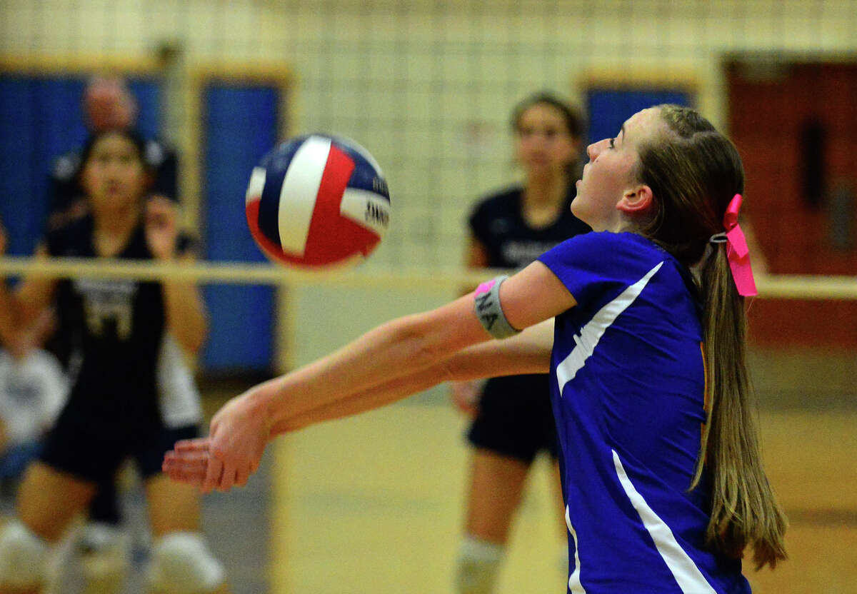 Seymour's Jillian Murphy bumps the ball, during Class S girls volleyball semifinal action against Morgan in East Haven, Conn. on Wednesday Nov. 12, 2014.