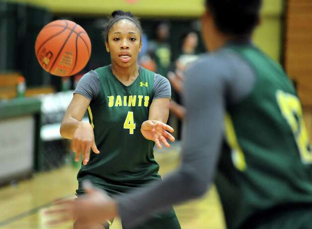 Siena's Emia Willingham, left, passes the ball during basketball practice on Friday, Nov. 7, 2014, at Siena College in Loudonville, N.Y. (Cindy Schultz / Times Union) Photo: Cindy Schultz / 00029383A
