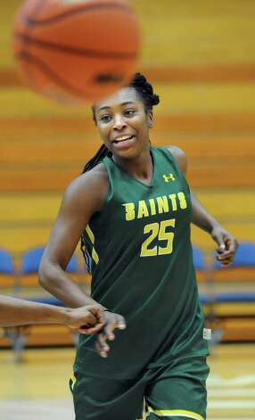 Siena's Tehresa Coles passes the ball during basketball practice on Friday, Nov. 7, 2014, at Siena College in Loudonville, N.Y. (Cindy Schultz / Times Union) Photo: Cindy Schultz / 00029383A