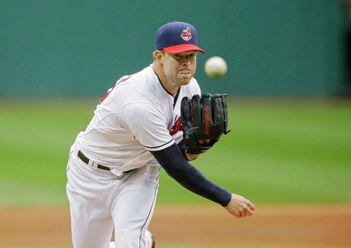 The Cleveland Indians' Corey Kluber pitches against the Minnesota Twins in the first game of a baseball doubleheader in Cleveland. With every win, every strikeout and an almost robotic efficiency, the Indians right-hander has quietly become one of the AL's best pitchers and, just maybe, its Cy Young Award winner.