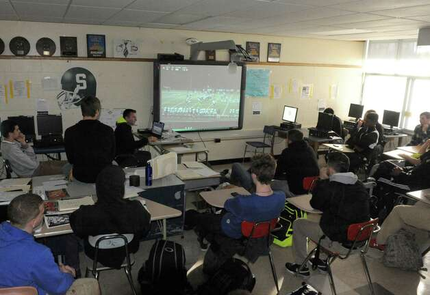 Schalmont High School football players going over game film with coach Joe Whipple, center, Wednesday, Nov. 12, 2014, in Rotterdam, N.Y. (Michael P. Farrell/Times Union) Photo: Michael P. Farrell / 00029455A