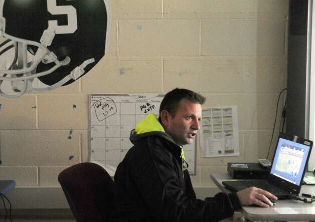 Schalmont High School football coach Joe Whipple goes over game film with his team Wednesday, Nov. 12, 2014, in Rotterdam, N.Y. (Michael P. Farrell/Times Union) Photo: Michael P. Farrell / 00029455A
