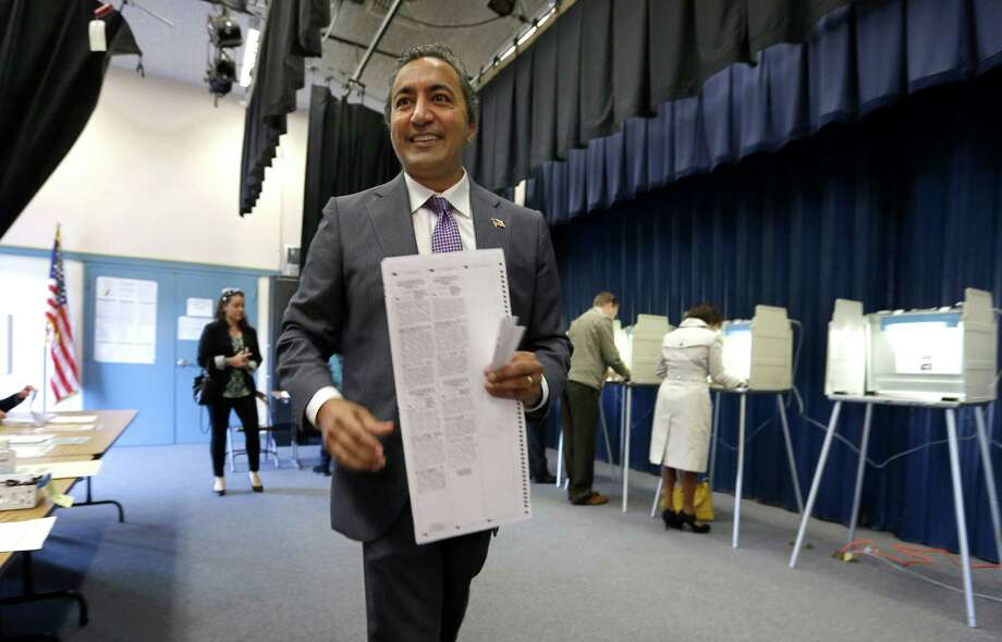 Incumbent Democratic Rep. Ami Bera goes to a cast his ballot while voting in Elk Grove, Calif. Tuesday, Nov. 4, 2014. Bera won a tight race with Republican Doug Ose for the California 7th District seat, one of the most hotly contested congressional seats in the country Photo: Rich Pedroncelli / Associated Press / AP