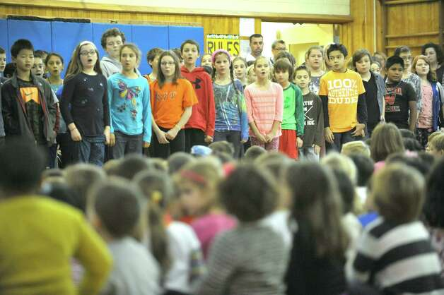 Rosendale Elementary School choir performs during an assembly at the school where fourth grade teacher Roseann Maurantonio was awarded a Milken Educator Award on Wednesday, Nov. 12, 2014, in Niskayuna, N.Y.   (Paul Buckowski / Times Union) Photo: Paul Buckowski / 00029448A
