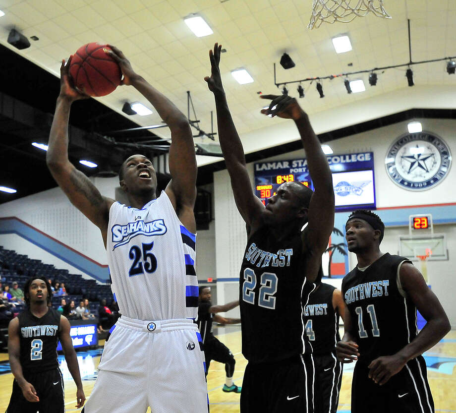 Lamar State College - Port Arthur's Darius Paul maneuvers for a shot around the blocking efforts of Houston Community College's Ambroce Odhiambo as the Seahawks take on the Eagles at home Saturday.