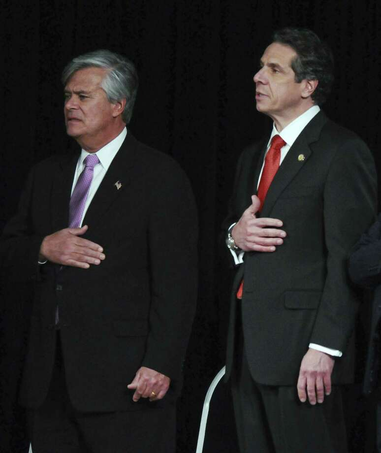 Senate Majority Leader Dean Skelos, left, and Gov. Andrew Cuomo, right, recite the Pledge of Allegiance during Gov. Cuomo's 2012 State of the State address Wednesday Jan. 4, 2012, at the Empire State Plaza Convention  Center in Albany, N.Y. (Philip Kamrass / Times Union archive) Photo: Philip Kamrass / 10015982B