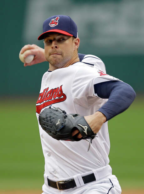 FILE - In this Sept. 11, 2014, file photo, Cleveland Indians starting pitcher Corey Kluber delivers against the Minnesota Twins during a a baseball game in Cleveland. Kluber won the AL Cy Young Award, in balloting announced Wednesday, Nov. 12, 2014, by the Baseball Writers' Association of America.  (AP Photo/Mark Duncan, File) Photo: Mark Duncan, STF / AP