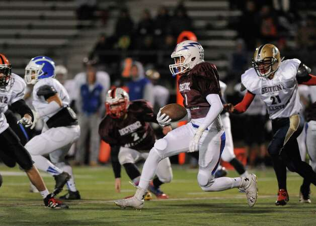 Nick Anderson of Saratoga (North Team) runs back the opening kickoff for a large gain during the 2014 Section 2 Exceptional Senior football game on Wednesday Nov. 12, 2014 in Clifton Park, N.Y. (Michael P. Farrell/Times Union) Photo: Michael P. Farrell / 00029456A