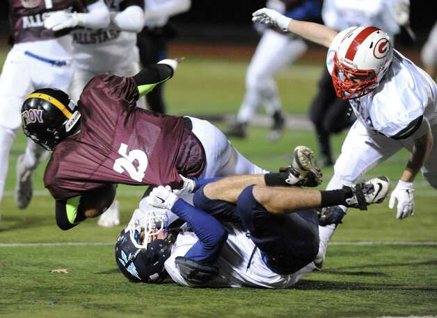 Elijah Bethel of Troy (North Team) is tackled by Alex Bethoney of Columbia (South Team) during the 2014 Section 2 Exceptional Senior football game on Wednesday Nov. 12, 2014 in Clifton Park, N.Y. (Michael P. Farrell/Times Union) Photo: Michael P. Farrell / 00029456A