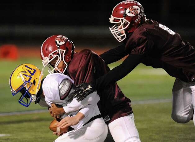 Neiko Bianchino of Bishop Maginn is sacked by Scotia's Shannon Smith during the 2014 Section 2 Exceptional Senior football game on Wednesday Nov. 12, 2014 in Clifton Park, N.Y. (Michael P. Farrell/Times Union) Photo: Michael P. Farrell / 00029456A
